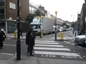 Traffic on Action Street which has zebra crossings at this junction with Gray's Inn Road and at the other end, the junction with King's Cross Road