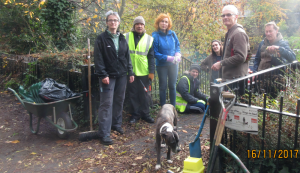 Photo of the London Wildlife volunteers hard at work on the raised path above the canal, on the Islington side, at King's Cross.