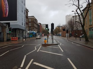 Pentonville Road - Weston Rise. Far left see bust stop. In front pedestrian traffic light, that must be operated individually to cross each side. Weston Rise on the right. In ordre to to rech the bus stip one must walk down 40 meters. wait for green to cross West Bound Lane, and then the same for East-bound lane, and then walk back 60-70 meters